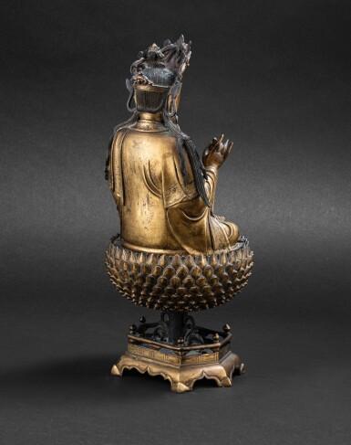 View 3. Thumbnail of Lot 39. Statue de Guanyin en bronze doré Dynastie Ming, XVIIE siècle | 明十七世紀 鎏金銅觀音菩薩坐像 | A large gilt-bronze figure of Guanyin on a lotus base, Ming Dynasty, 17th century.