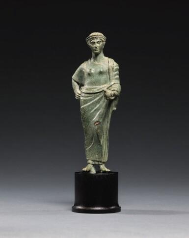 View 1. Thumbnail of Lot 11. AN ETRUSCAN BRONZE FIGURE OF A WOMAN, CIRCA 425-400 B.C..