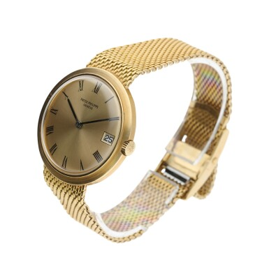 View 3. Thumbnail of Lot 135. PATEK PHILIPPE  |  REFERENCE 3565/1 'IOS' A YELLOW GOLD AUTOMATIC BRACELET WATCH WITH DATE, MADE IN 1968.