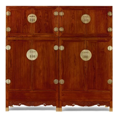 View 1. Thumbnail of Lot 88. A RARE PAIR OF HUANGHUALI COMPOUND CABINETS, SIJIANGUI MING DYNASTY, 17TH CENTURY | 明十七世紀 黃花梨雕雙龍供蓮紋四件頂箱櫃成對.