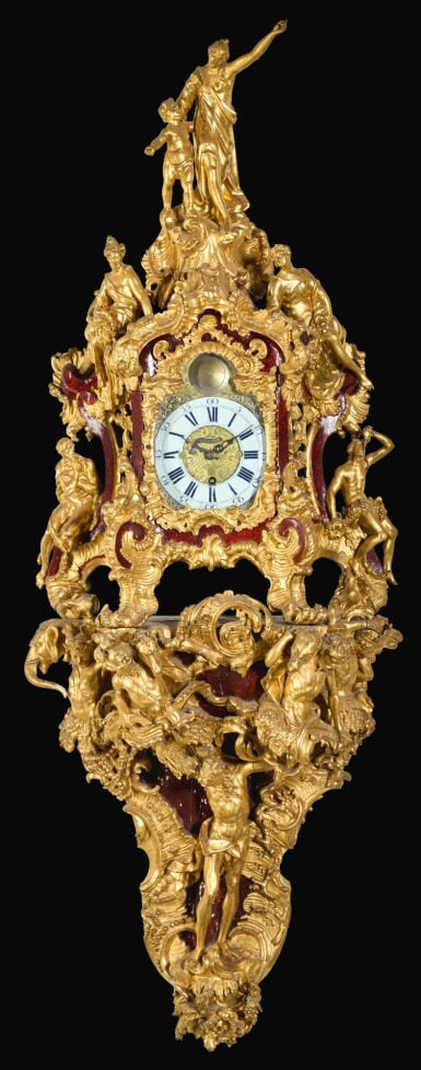 View 1. Thumbnail of Lot 146. AN AUSTRIAN ROCOCO CARVED GILTWOOD BRACKET CLOCK, MID-18TH CENTURY, DIAL AND MOVEMENT ASSOCIATED.