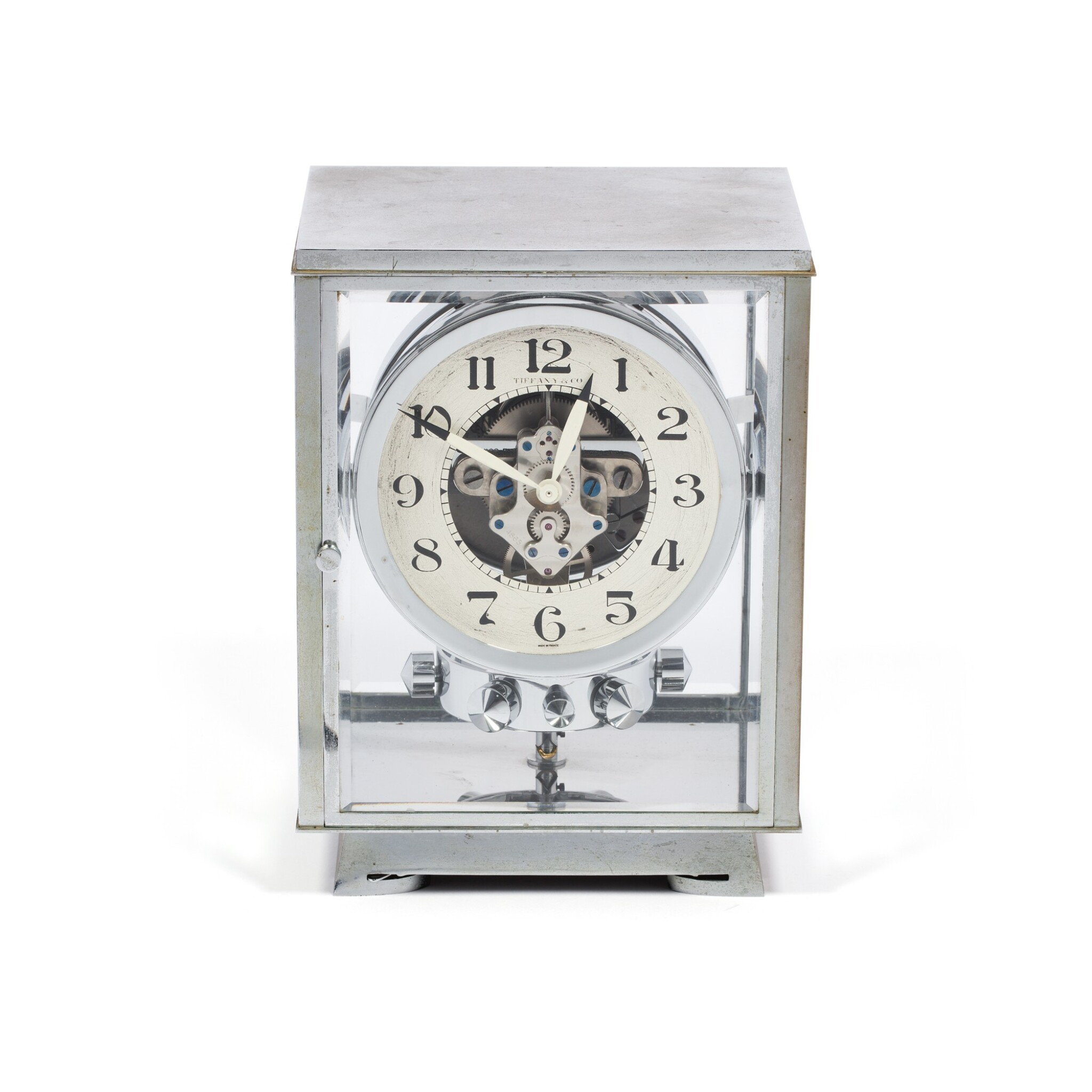 View full screen - View 1 of Lot 50. J.L. REUTTER | RETAILED BY TIFFANY & CO.: ATMOS,  A RARE AND EARLY CHROME PLATED PERPETUAL CLOCK WOUND BY BAROMETRIC PRESSURE, CIRCA 1935 .