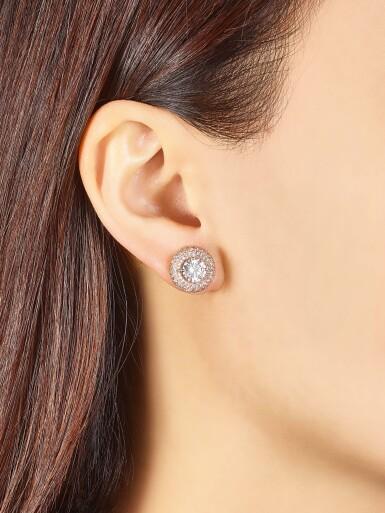 View 1. Thumbnail of Lot 1013. Pair of Diamond Earrings | 格拉夫| 1.01及1.00克拉 圓形 E色 鑽石 耳環一對 (小鑽石共重約1.60克拉).