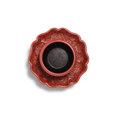 View 3. Thumbnail of Lot 3662. An exceptional and important carved cinnabar lacquer bowl stand, Ming dynasty, Hongwu period, Yongle and Xuande marks   明洪武 剔紅花卉紋盞托 《大明永樂年製》、《大明宣德年製》款.
