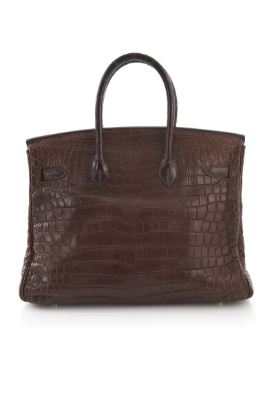 View 3. Thumbnail of Lot 20. Matte havanne niloticus crocodile, canvas and gold plated hardware handbag, Birkin 35, Hermès, 2002.