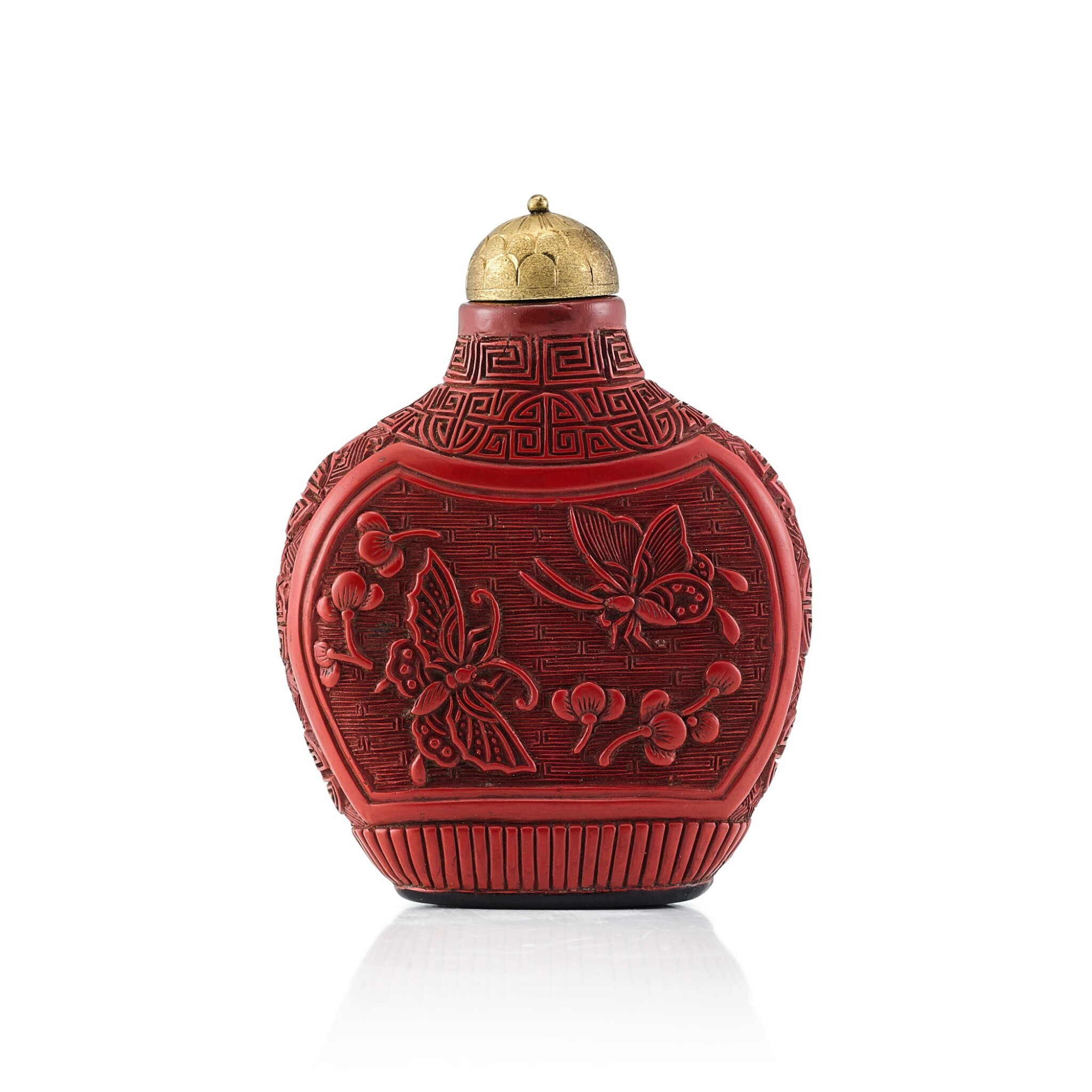 View 1 of Lot 3007. A Carved Cinnabar Lacquer 'Flowers and Butterflies' Snuff Bottle Qing Dynasty, 18th - 19th Century | 清十八至十九世紀 剔紅蝶戀花鼻煙壺.