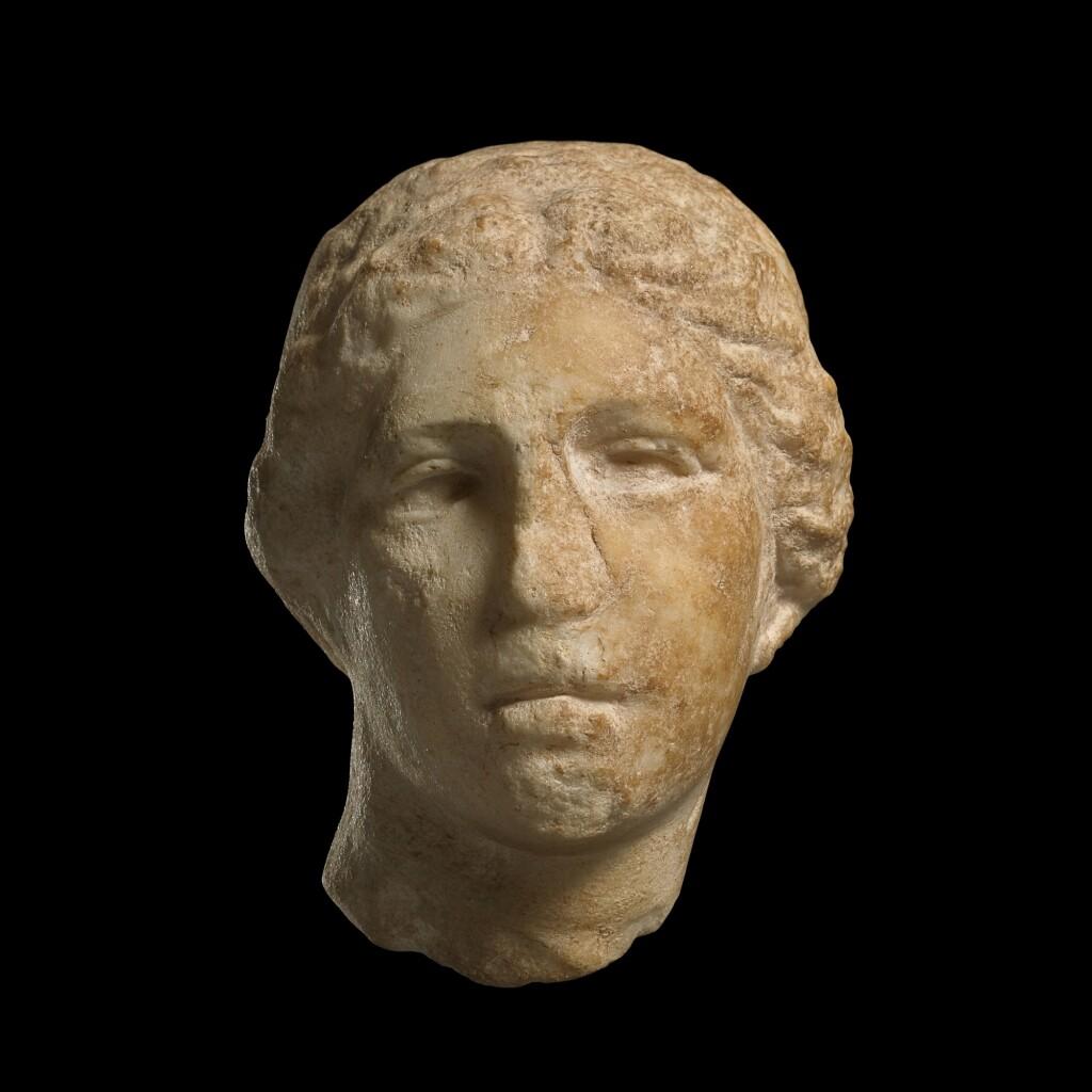 A GREEK MARBLE HEAD OF A GODDESS, CIRCA MID 4TH CENTURY B.C.