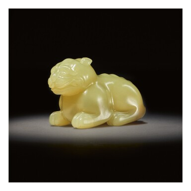A RARE YELLOW JADE CARVING OF A MYTHICAL BEAST,  SONG - MING DYNASTY