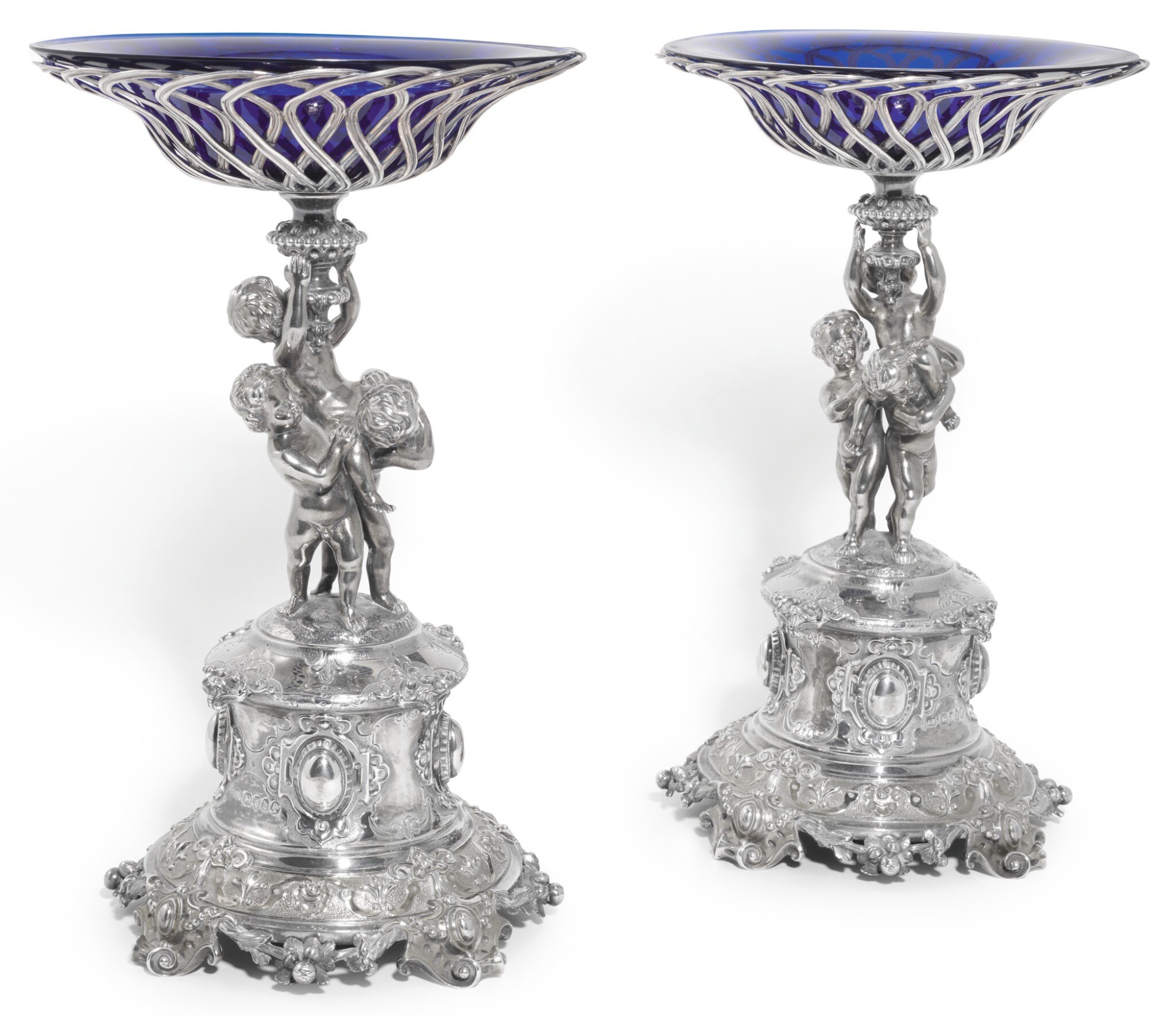 View full screen - View 1 of Lot 144. A PAIR OF VICTORIAN PARCEL-GILT SILVER COMPORTS, ALEXANDER MACRAE FOR HARRY EMMANUEL, LONDON, 1859.