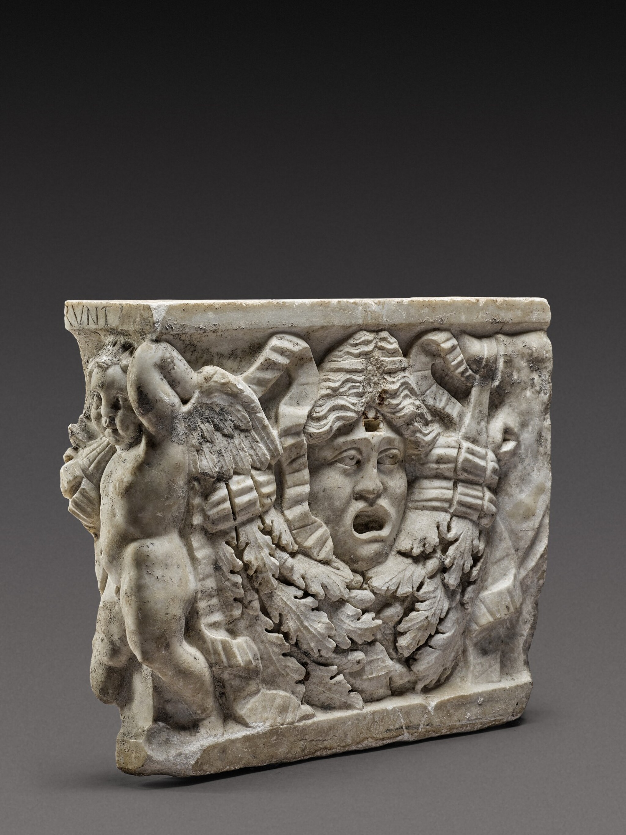 View 1 of Lot 80. A Roman Marble Garland Sarcophagus Fragment, circa A.D. 135.