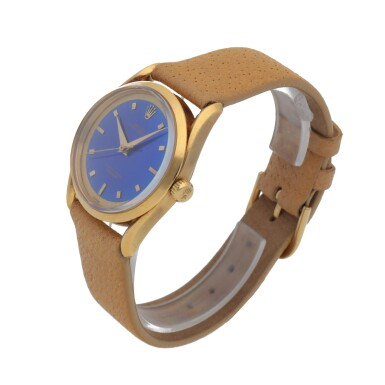 View 2. Thumbnail of Lot 33. 'BOMBAY' REF 6290 YELLOW GOLD WRISTWATCH WITH FANCY LUGS AND BLUE ENAMEL DIAL CIRCA 1953 [勞力士6290型號「BOMBAY」黃金腕錶備藍色琺瑯錶盤,年份約1953].