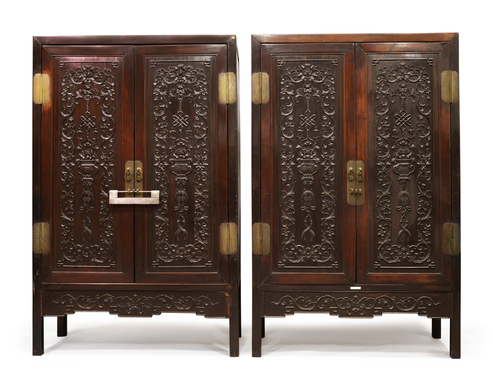 View 1 of Lot 1043. A PAIR OF CARVED 'HONGMU' SQUARE-CORNER CABINETS, LATE 19TH / EARLY 20TH CENTURY.