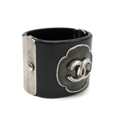 View 2. Thumbnail of Lot 174. CHANEL | BLACK PERSPEX CUFF WITH A RESIN FILLED CAMELIA STUDDED FLORAL OUTLINE AND ANTHRACITE TONE HARDWARE AND CC EMBELLISHMENT, 2015.