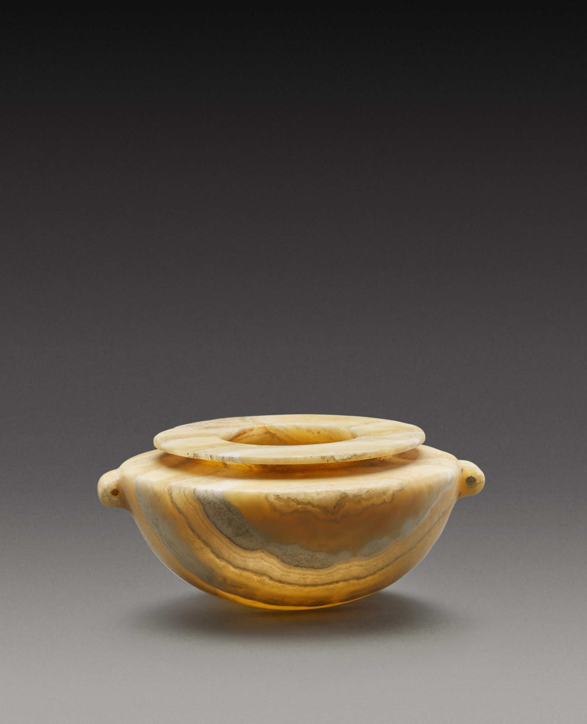 View 1 of Lot 46. An Egyptian Alabaster Jar, Early Dynastic Period, 1st/2nd Dynasty, circa 2920-2649 B.C..