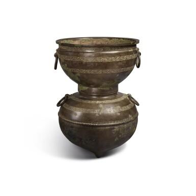 View 2. Thumbnail of Lot 20. An archaic bronze ritual food steamer (Yan), Eastern Zhou dynasty, early Warring States period   東周 戰國初 青銅交龍紋鋪首耳甗.