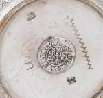 A GERMAN SILVER AND SILVER-GILT BEAKER INSERT WITH COINS, BY JOHANN GEORG GODRIO, BERLIN, CIRCA 1711 |  GOBELET À PIÈCES EN ARGENT ET VERMEIL, PAR JOHANN GEORG GODRIO, BERLIN, VERS 1711-1726