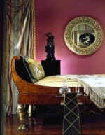 A TUSCAN NEOCLASSICAL BURR MAPLE AND PARCEL GILT DAYBED ON PLINTH, PROBABLY LUCCA, CIRCA 1820