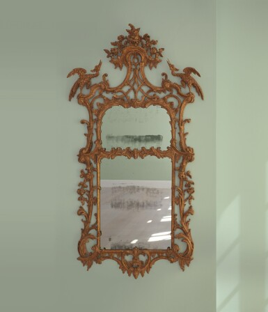 A GEORGE III CARVED GILTWOOD MIRROR, CIRCA 1760