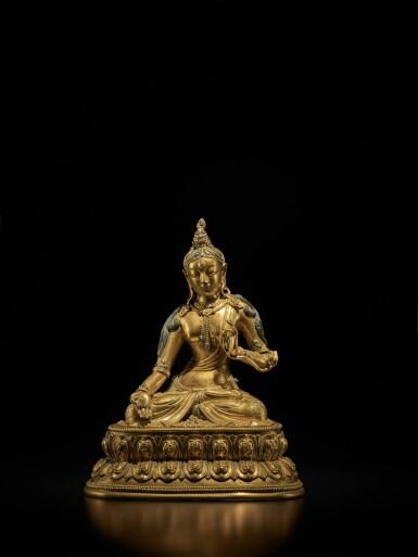 View 1. Thumbnail of Lot 107. A Tibeto-Chinese gilt-bronze figure of White Tara, Circa 1700 | 約1700年 藏傳銅鎏金白度母坐像.