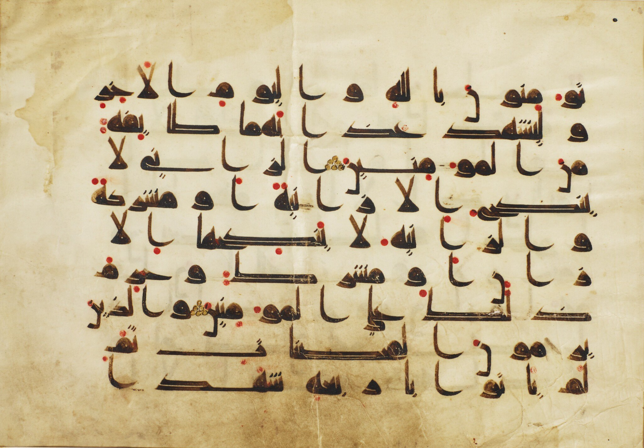 View full screen - View 1 of Lot 3. A QUR'AN LEAF IN KUFIC SCRIPT ON VELLUM, NORTH AFRICA OR NEAR EAST, 9TH CENTURY AD.