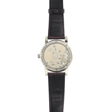 View 5. Thumbnail of Lot 290. Reference 110.029 Lange 1  A white gold wristwatch with date, power reserve indication and mother-of-pearl dial, Circa 2000 .