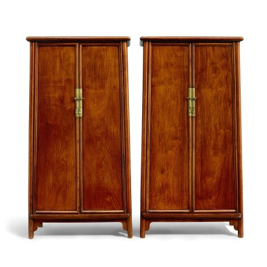 View 1. Thumbnail of Lot 19. A pair of huanghuali round-cornered tapered cabinets, yuanjiaogui Late Ming – early Qing dynasty   明末至清初 黃花梨圓角櫃成對.