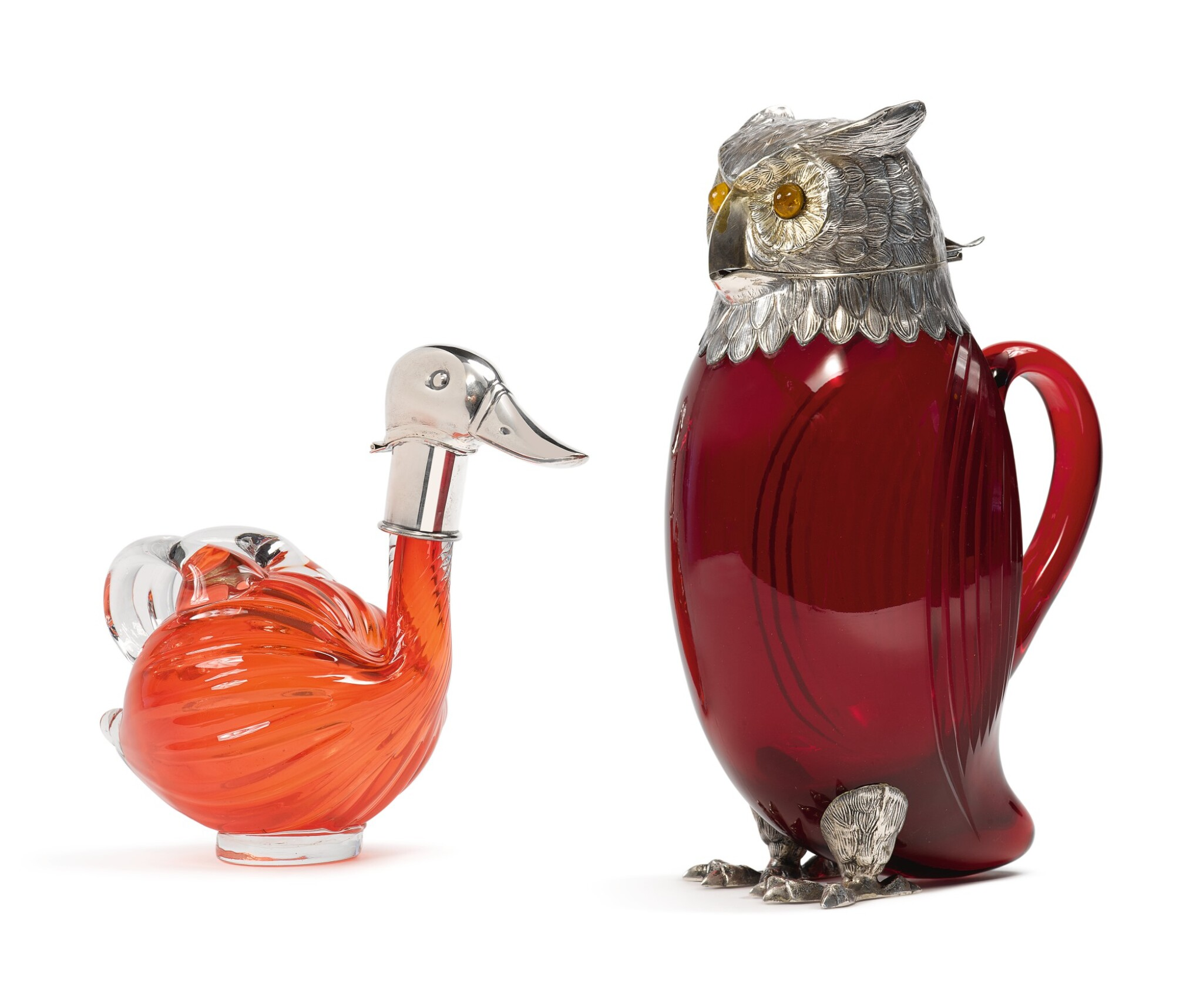 View full screen - View 1 of Lot 273. TWO SILVER-MOUNTED GLASS BIRD-FORM CLARET JUGS, 20TH CENTURY.