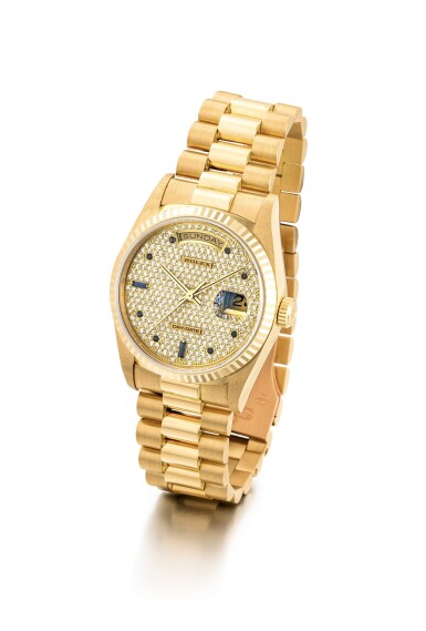 "View 2. Thumbnail of Lot 2109. ROLEX | DAY-DATE, REFERENCE 18238, A YELLOW GOLD, DIAMOND AND SAPPHIRE-SET WRISTWATCH WITH DAY, DATE AND BRACELET, CIRCA 1991 | 勞力士 | ""Day-Date 型號18238 黃金鑲鑽石及藍寶石鏈帶腕錶,備日期及星期顯示,機芯編號X629862,約1991年製""."