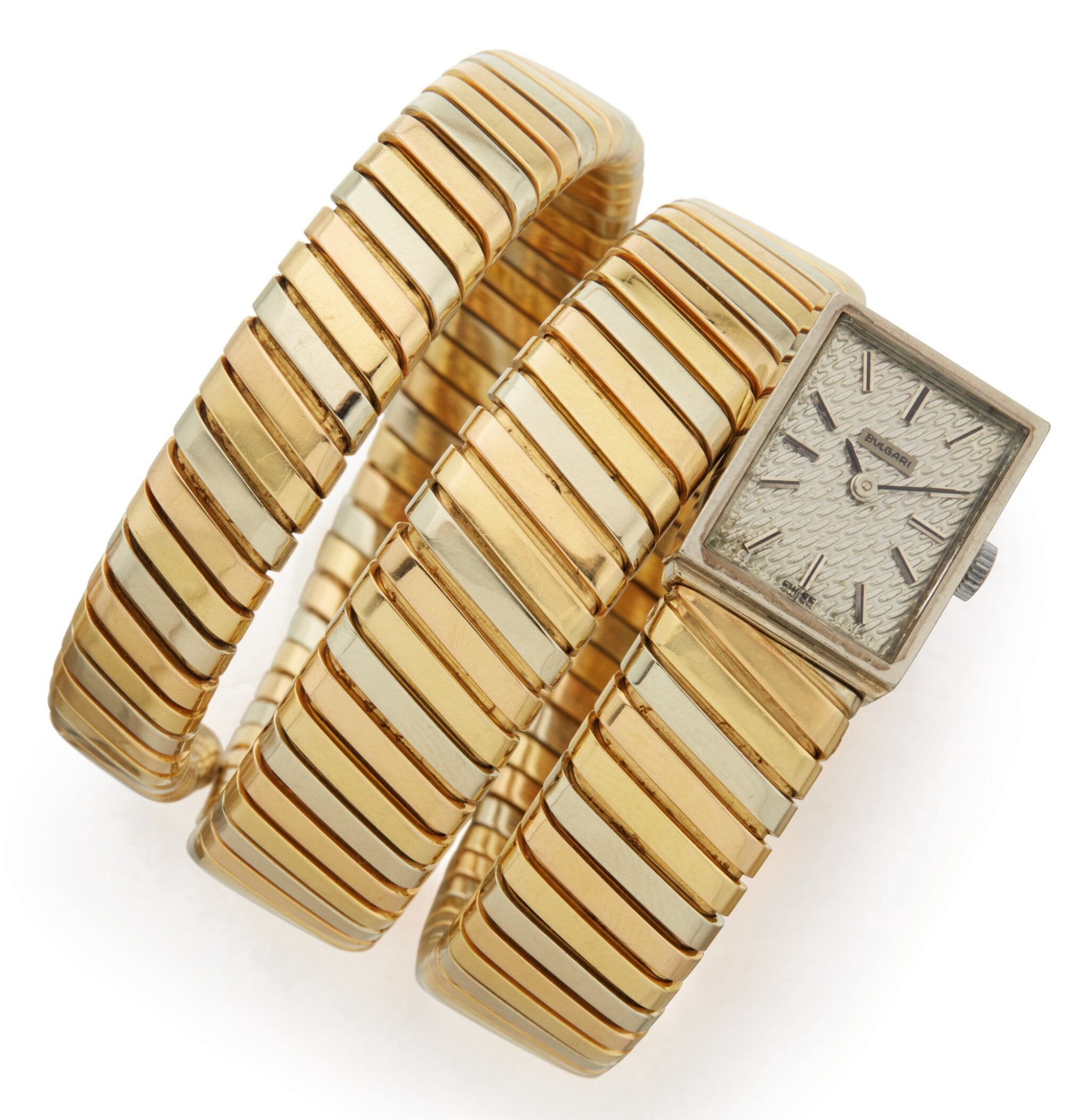 View full screen - View 1 of Lot 391. TRI-COLORED GOLD 'TUBOGAS' BRACELET-WATCH, BULGARI.