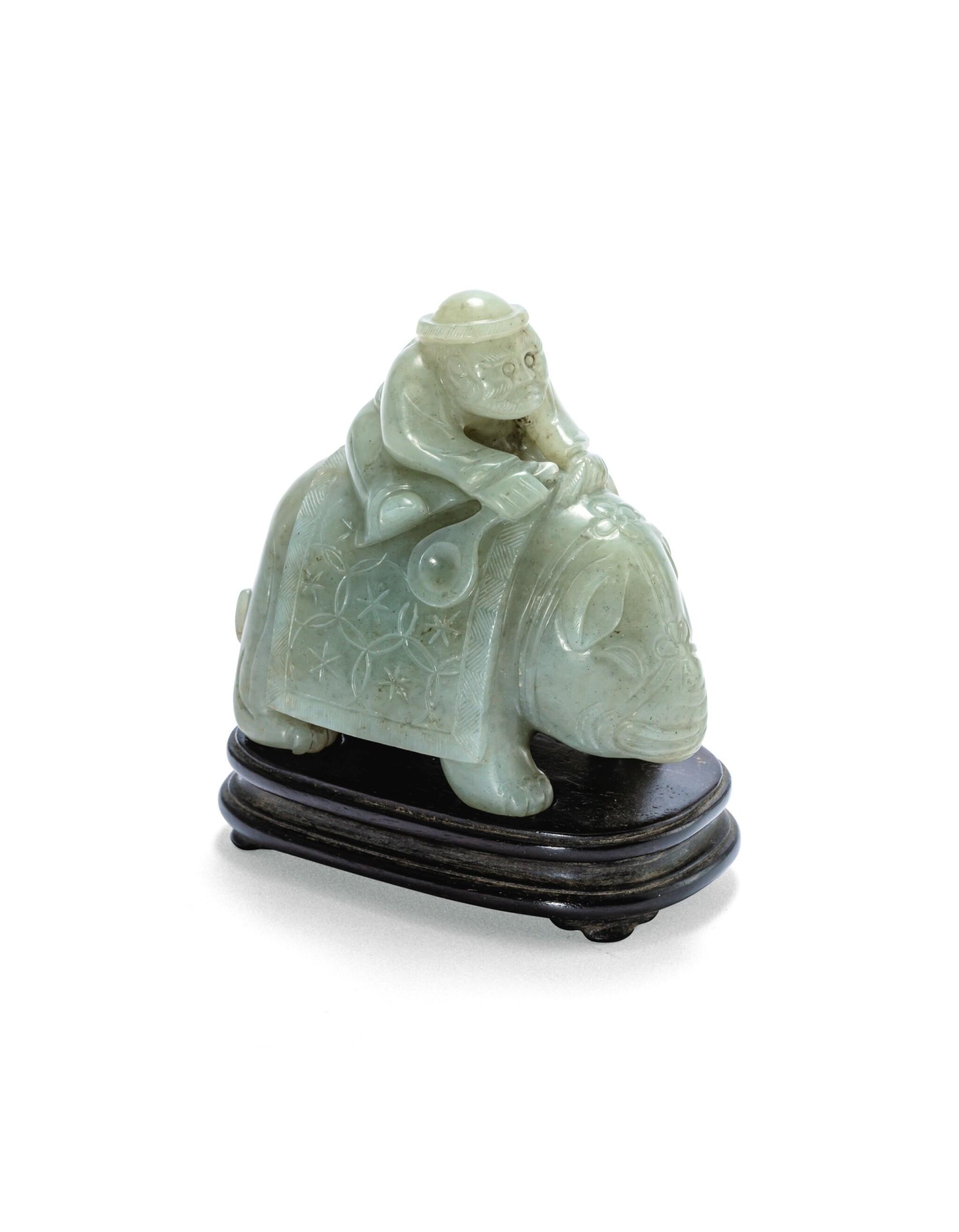 View 1 of Lot 215. Statuette d'un éléphant et son cornac en jade céladon Dynastie Qing | 清 青白玉胡人騎象擺件 | A celadon jade 'foreigner on an elephant' group, Qing Dynasty.