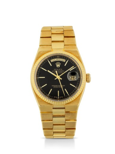 ROLEX | OYSTERQUARTZ DAY-DATE, REF 19018 YELLOW GOLD WRISTWATCH WITH DAY, DATE AND BRACELET CIRCA 1981