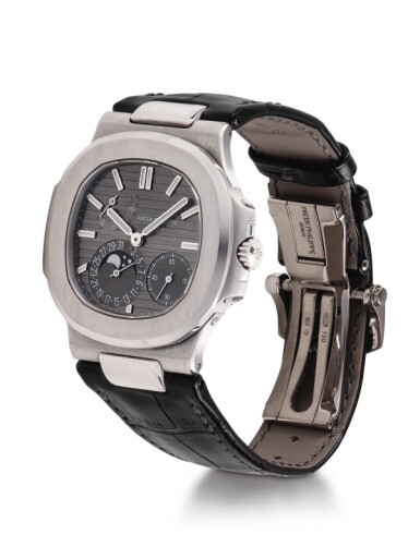 PATEK PHILLIPE | NAUTILUS, REF 5712 WHITE GOLD WRISTWATCH WITH DATE, MOON PHASES AND POWER RESERVE INDICATION CIRCA 2016