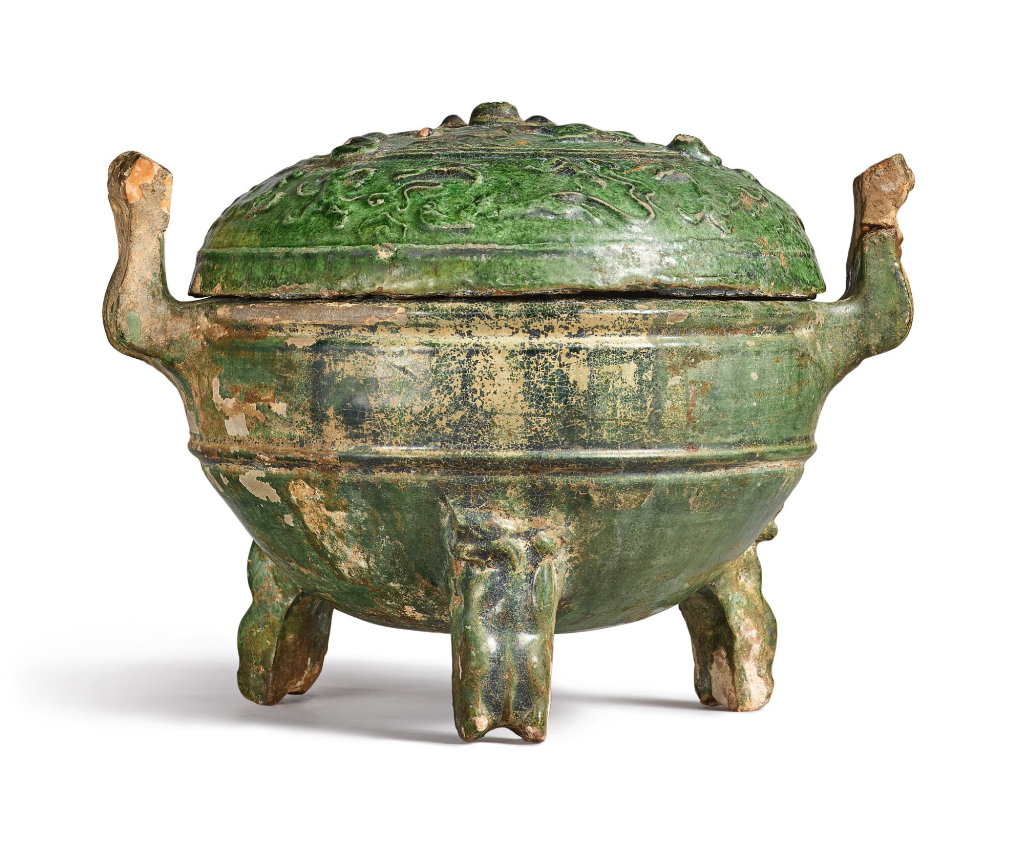 View full screen - View 1 of Lot 1069. A GREEN-GLAZED POTTERY DING AND COVER, HAN DYNASTY.