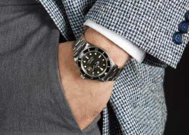 View 4. Thumbnail of Lot 5. ROLEX | SUBMARINER, REFERENCE 16800,  STAINLESS STEEL WRISTWATCH WITH DATE AND BRACELET, CIRCA 1980.