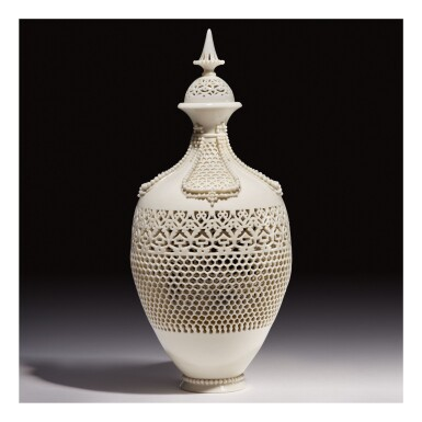 A ROYAL WORCESTER RETICULATED PORCELAIN VASE AND COVER BY GEORGE OWEN CIRCA 1913, DATED 1919