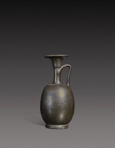 View 1. Thumbnail of Lot 60. A Campanian Black-glazed Squat Lekythos, 4th Century B.C..