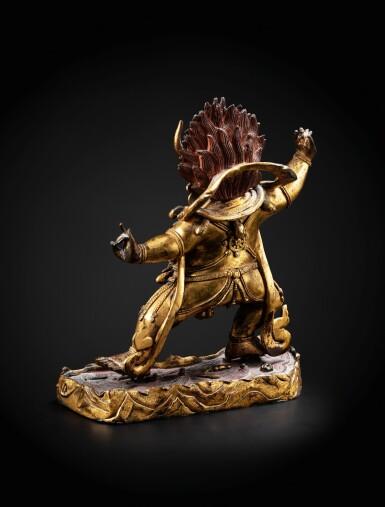 View 3. Thumbnail of Lot 28. A large gilt-bronze figure of Yama Dharmaraja Qing dynasty, 18th century   清十八世紀 鎏金銅閻摩法王立像.