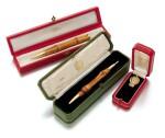 Wood pencil and ballpoint pen and a key (Matita e penna in legno e una chiave)