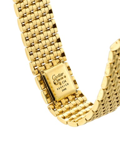 """View 3. Thumbnail of Lot 2053. CARTIER   PANTHÉRE, REFERENCE 2449, A UNIQUE YELLOW GOLD AND YELLOW DIAMOND-SET BRACELET WATCH, MADE ON SPECIAL REQUEST, CIRCA 2000   卡地亞   """"Panthére 型號2449 獨一無二黃金鑲黃鑽石鏈帶腕錶,為特殊訂製,錶殼編號99851CD,約2000年製""""."""