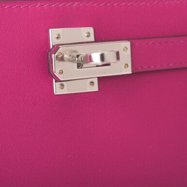 View 6. Thumbnail of Lot 16. Hermès Rose Pourpre Mini Kelly Pochette of Swift Leather with Palladium Hardware.