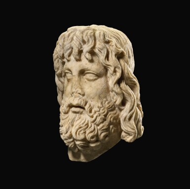 View 4. Thumbnail of Lot 32. A ROMAN MARBLE HEAD OF SARAPIS, CIRCA 2ND CENTURY A.D., ON 19TH CENTURY HERM SHOULDERS.