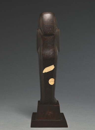 View 6. Thumbnail of Lot 66. AN EGYPTIAN BROWN SERPENTINE USHABTI OF NEDJEM-IB, LATE 12TH/13TH DYNASTY, CIRCA 1800-1640 B.C..