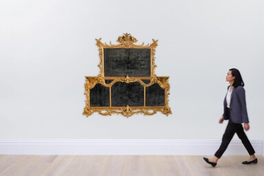 View 4. Thumbnail of Lot 68. A George II carved giltwood overmantel mirror, circa 1755-60.