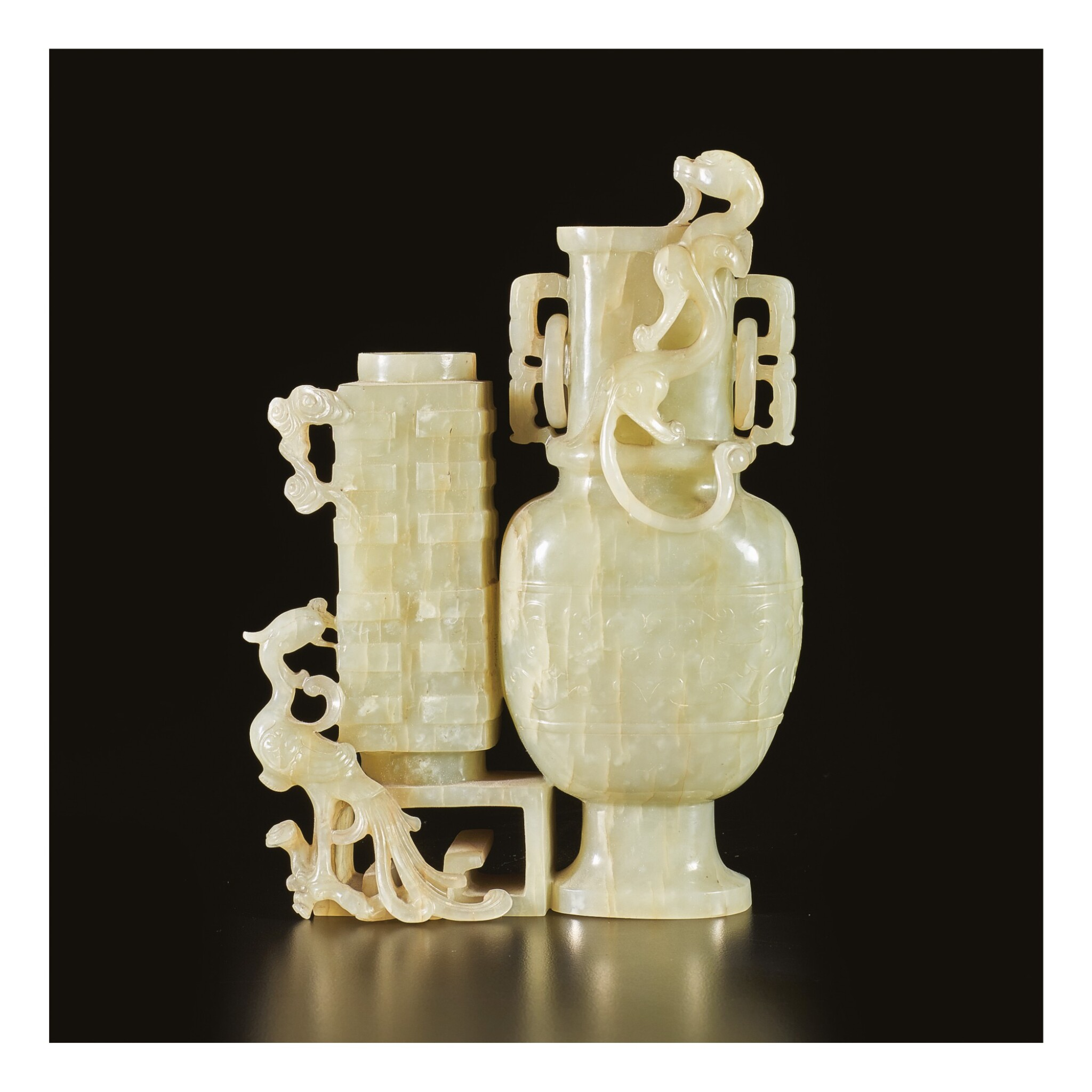 View 1 of Lot 649. A CELADON JADE 'CHILONG AND PHOENIX' DOUBLE VASE GROUP, QING DYNASTY, 18TH / EARLY 19TH CENTURY.