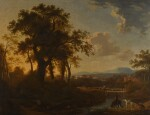 STUDIO OF GEORGE BARRET, R.A. | AN EXTENSIVE WOODED RIVER LANDSCAPE, WITH A TRAVELLER WATERING HIS HORSE IN THE FOREGROUND AND FIGURES ON A BRIDGE BEYOND