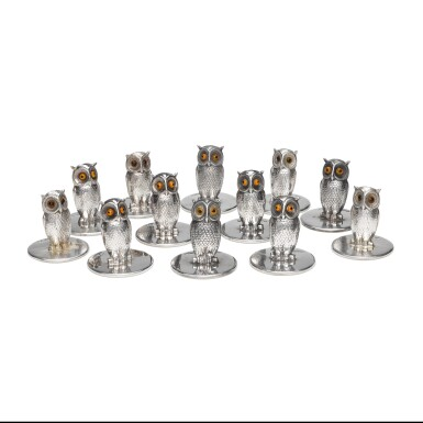 View 1. Thumbnail of Lot 34. A set of twelve silver and glass owl menu holders, S. Mordan & Co., Chester, 1905-1912.