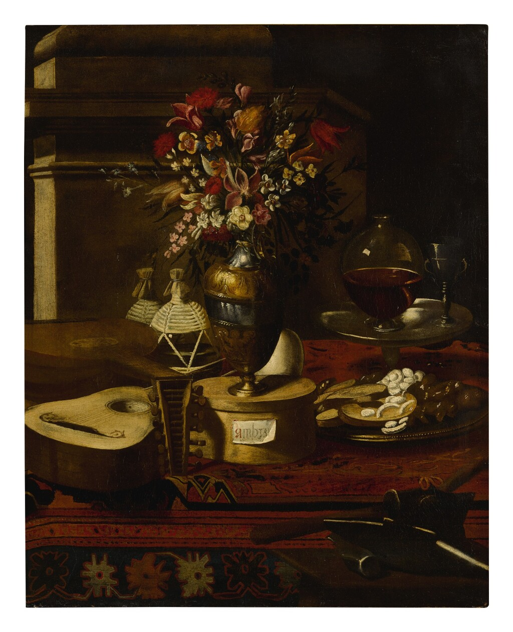 ATTRIBUTED TO PIER FRANCESCO CITTADINI   STILL LIFE OF A VASE OF FLOWERS, MUSICAL INSTRUMENTS, TWO FLASKS, A DISH WITH SWEETS AND OTHER OBJECTS ON A TABLE
