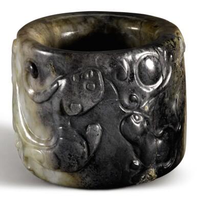 A MOTTLED GREY AND WHITE JADE THUMB RING QING DYNASTY, 19TH CENTURY | 清十九世紀 灰玉瑞獸紋扳指