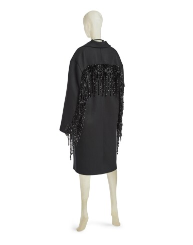 View 3. Thumbnail of Lot 8. PRADA | WOOL BEADED FRINGE COAT AND VANITY NECKLACE,   WORN BY THERESA HAYES.