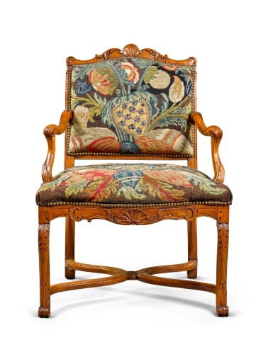 View 2. Thumbnail of Lot 52. A Régence provincial carved beechwood fauteuil, circa 1730.